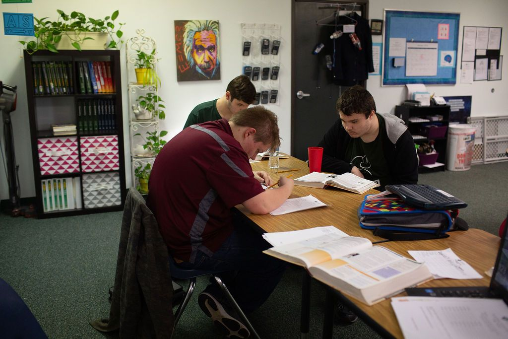 High school students working at table